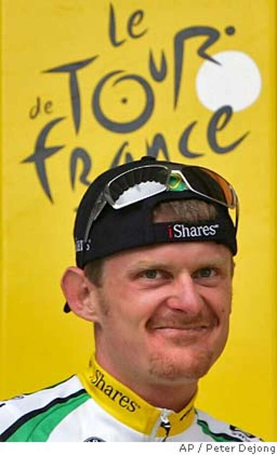 ** FILE ** New overall leader Floyd Landis of the US arrives on the podium after the 11th stage of the Tour de France cycling race between Tarbes, southwestern France, and Val d'Aran (Pla-de-Beret), Spain, in this Thursday, July 13, 2006 file photo. (AP Photo/Peter Dejong) JULY 13, 2007 FILE PHOTO. Photo: PETER DEJONG