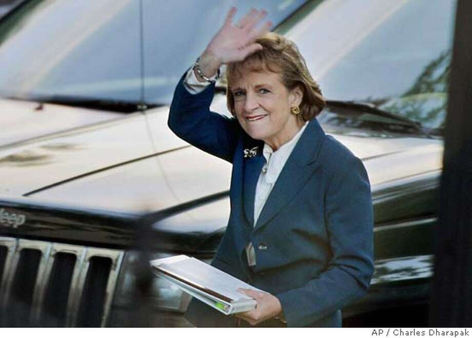 White House counsel Harriet Miers smiles and waves as she walks into the White House, Thursday, Oct. 27, 2005, in Washington. Miers withdrew her nomination to be a Supreme Court justice Thursday in the face of stiff opposition and mounting criticism about her qualifications. (AP Photo/Charles Dharapak) Photo: CHARLES DHARAPAK