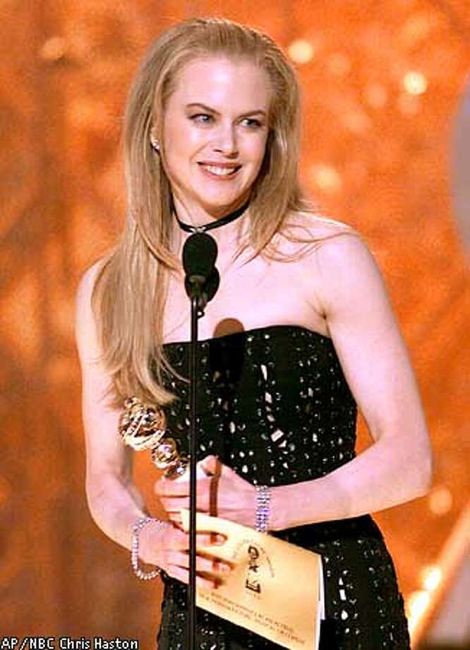 "EMBARGOED AT THE REQUEST OF THE HOLLYWOOD FOREIGN PRESS ASSOCIATION AND DICK CLARK PRODUCTIONS FOR USE UPON CONCLUSION OF THE GOLDEN GLOBE AWARDS LIVE TELECAST AT 11:00 PM EST--Actress Nicole Kidman accepts her award for best performance by an actress in a motion picture comedy or musical for her work in ""Moulin Rouge!,"" at the 59th Annual Golden Globe Awards in Beverly Hills, Calif., Sunday, Jan. 20, 2002. (AP Photo/NBC, Chris Haston) Photo: CHRIS HASTON"