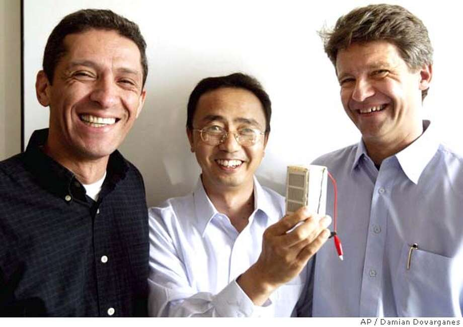CHRISTINA KOCI HERNANDEZ/CHRONICLE  (L) Farshid Arman,Flaming Zhou and (R) Siemen's cfo, Stefan Heuser.This story will look at several efforts, including a tiny start-up in the east bay that's making a miniature fuel cell with a 10-year shelf life. We'd like some shots of two of the guys behind the company posing with their fuel cell, which is about 4 inches high (for that reason, you may need to shoot them holding the thing up to their faces or something). we'd also like a shot or two of just the fuel cell itself. Their names are Farshid Arman and Flaming Zhou (yup, that's his real name, pronounced exactly the way it looks). Photo: CHRISTINA KOCI HERNANDEZ