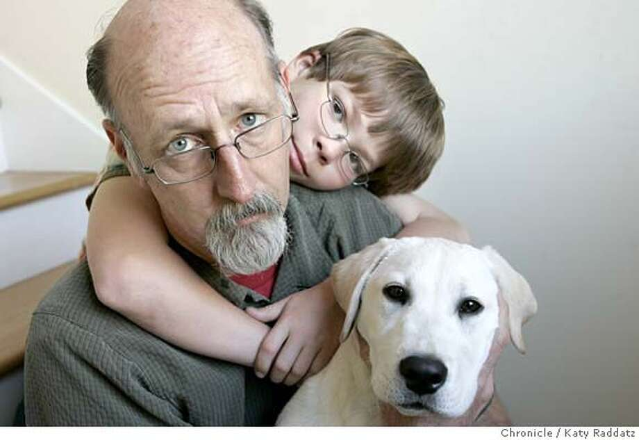 """TEACHERS26_039_RAD.jpg SHOWN: Jim Lammers, who taught at Miller Creek Middle School in Marin County and two schools in Richmond, and was named """"Marin County 1999 Teacher of the Year,"""" left teaching in 2002. He is shown with his son Adam Beeler-Lammers, and their puppy, """"Jango Fetch,"""" at their home in San Anselmo. These pictures were made in San Anselmo, CA. on Wednesday, April 25, 2007.  (Katy Raddatz/The Chronicle)  **Jim Lammers, Adam Beeler-Lammers, Jango Fetch Photo: Katy Raddatz"""