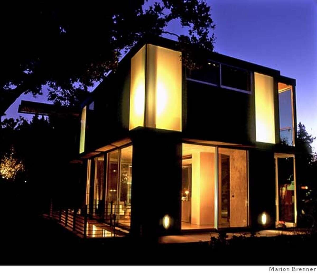 Architect Joseph Bellomo's lanternlike Palo Alto house is designed to fit perfectly under a landmark oak tree. Photo by Marion Brenner