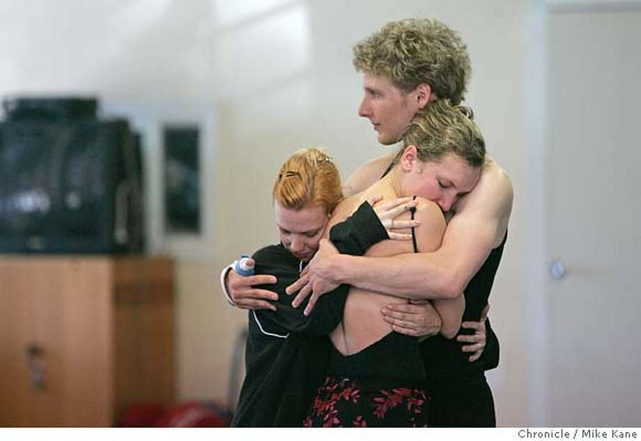 Smuin Ballett dancers Erin Yarborough, from left, Robin Cornwell and Aaron Thayer embrace during rehearsal at City Ballet School the day after the death of choreographer and company founder Michael Smuin in San Francisco, CA, on Tuesday, April, 24, 2007. photo taken: 4/24/07  Mike Kane / The Chronicle **Robin Cornwell Aaron Thayer Erin Yarborough Photo: MIKE KANE