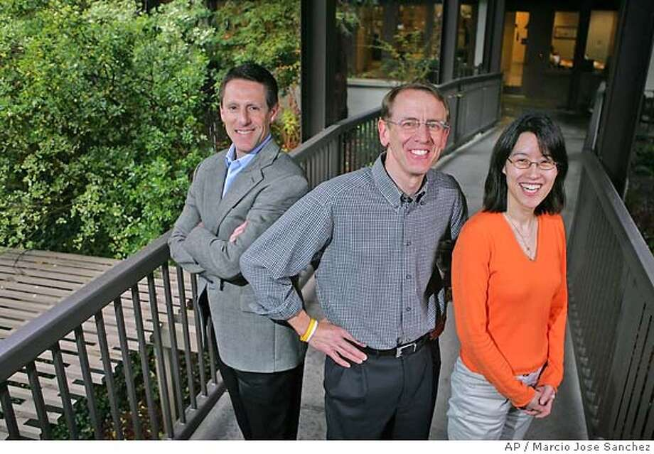 Venture capitalist John Doerr, middle, poses for a portrait with partners John Denniston, left, and Ellen Pao outside of their office in Menlo Park, Calif., April 4, 2006. Doerr is betting on an emerging sector known as clean technology with plans to devote $100 million to green technologies that help provide cleaner energy, transportation, air and water. (AP Photo/Marcio Jose Sanchez) Ran on: 12-09-2006  John Denniston said the organization is already talking with Congress.  Ran on: 03-15-2007  John Doerr is pushing for green technology nationwide. Photo: MARCIO JOSE SANCHEZ