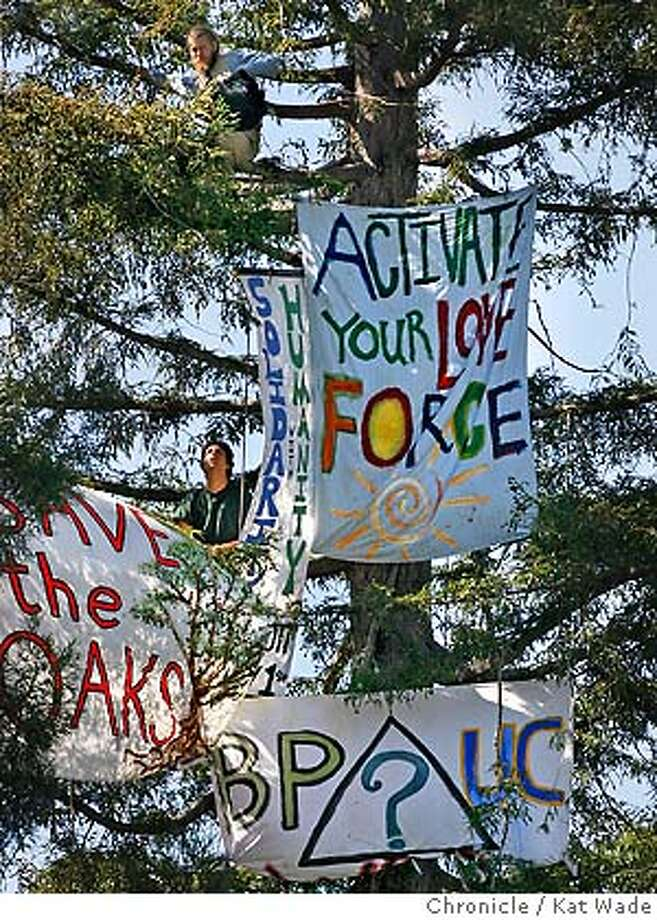 "Phoenix Coalition to Free UC members and students (L to R) Michael Schuck and Jason Ahmadi who are ""occupying"" a Redwood tree in Spraul plaza hang another protest sign at UC Berkeley. The coalition is protesting the University on its involvement with the military and certain corporations on Monday April 23, 2007. Schuck has been in the tree since Wednesday night while Ahmadi came down briefly to attend a wedding. Pheonix Coalition to Free UC member and student Michael Schuck who is ""occupying"" a Redwood tree in Spraul plaza at UC Berkeley to challenge the University on its involvement with the military and certain corporations on Monday April 23, 2007 . Schuck has been in the tree, day and night since Wednesday evening.  Kat Wade/The Chronicle Michael Schuck, (510)847-3746 and Jason Ahmadi (408)828-3705 (CQ, subject) Photo: Kat Wade"