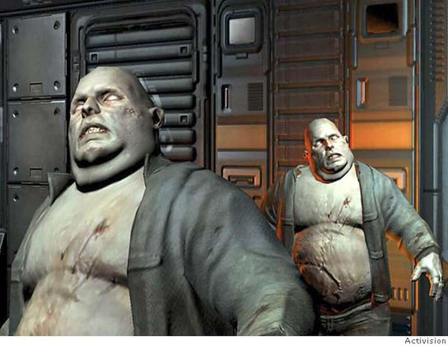 "Here are some unsavory characters from the game ""Doom III."" Photo: Ho"