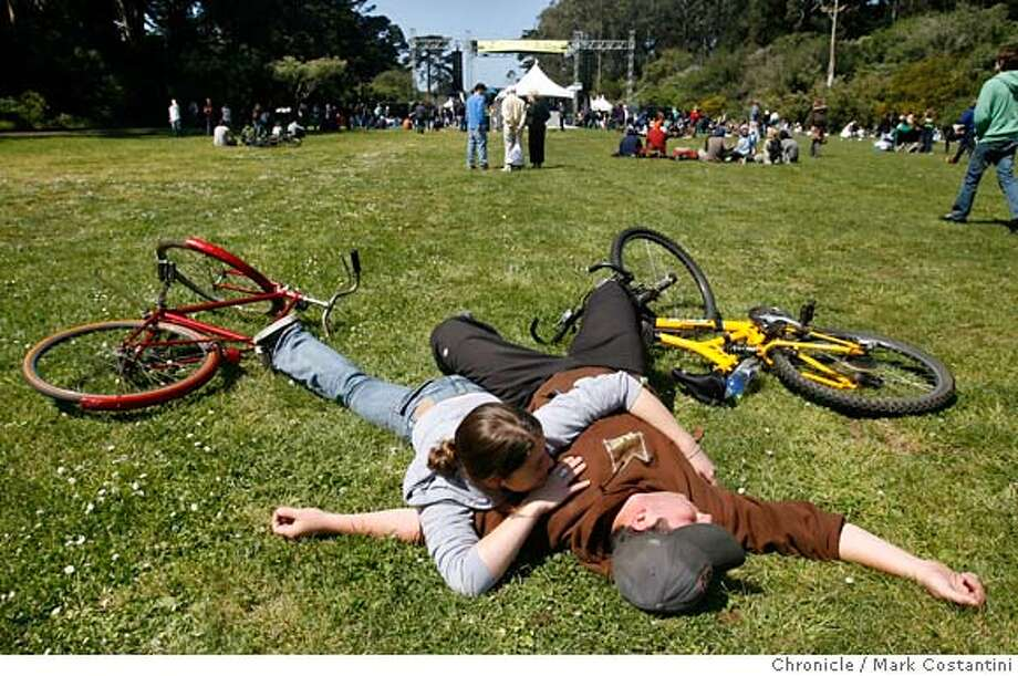 Errica Carroll and Ricardo Lizarraga and their bikes hang out in the meadow at the festival.  reen Apple Music and Arts Festival at Speedway Meadow in Golden Gate Park, part three days of environmental action, music, etc., in SF, Chicago and NY  PHOTO: Mark Costantini / The Chronicle MANDATORY CREDIT FOR PHOTOGRAPHER AND SAN FRANCISCO CHRONICLE/NO SALES-MAGS OUT Photo: MARK COSTANTINI