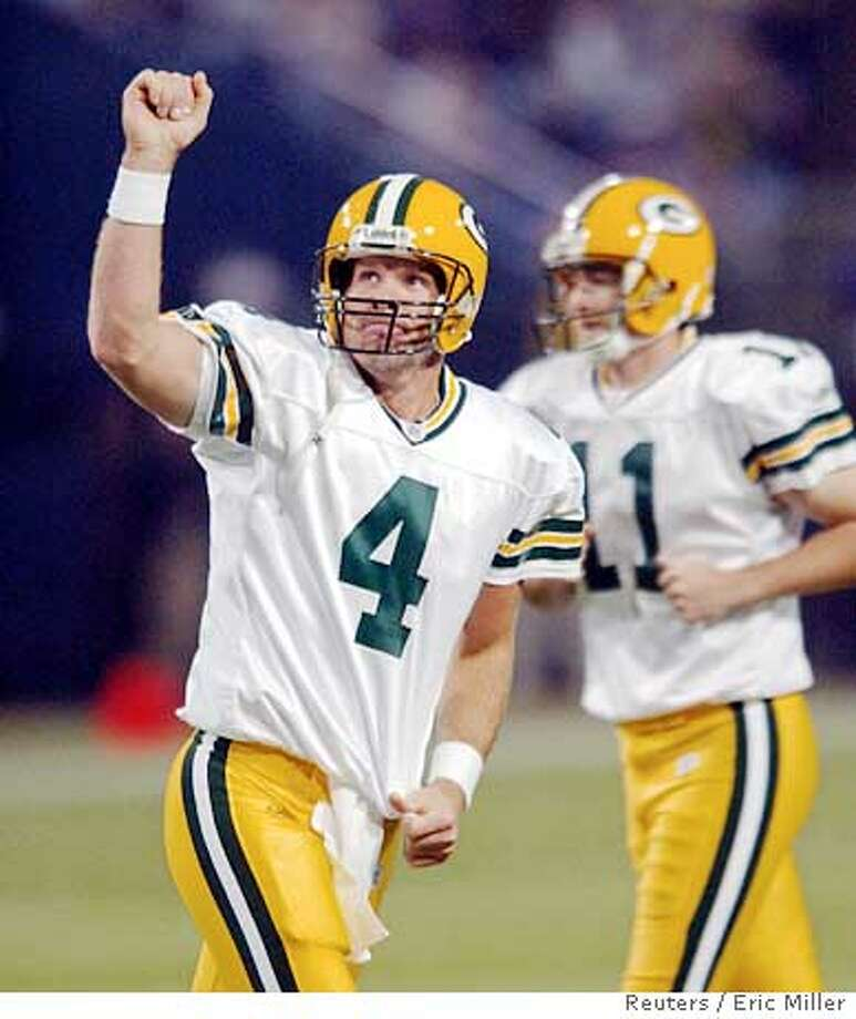 Green Bay Packers Brett Favre (4) celebrates his four-yard touchdown pass to receiver Antonio Chatman as punter B.J. Sander (11) comes on to the field for the extra point during the second quarter of the Packers' National Football League game against the Minnesota Vikings at the Metrodome in Minneapolis, October 23, 2005. Favre completed 28 of 36 passes for 318 yards and two touchdowns. Minnesota won 23-20. REUTERS/Eric Miller Ran on: 10-25-2005  Brett Favre faces the prospect of ending his career with a thoroughly irrelevant team. Ran on: 10-25-2005  Brett Favre faces the prospect of ending his career with a thoroughly irrelevant team. Photo: ERIC MILLER