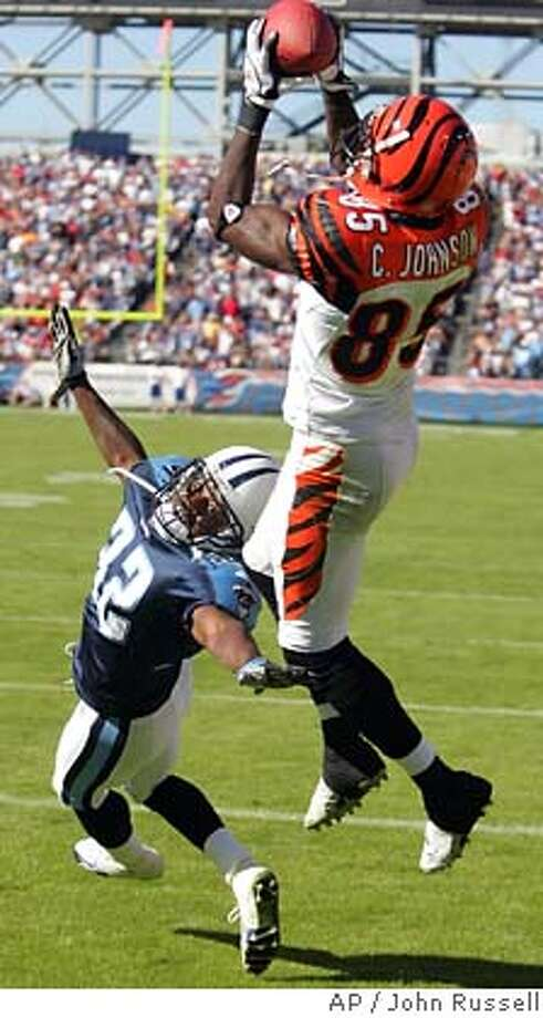 Cincinnati Bengals wide receiver Chad Johnson (85) grabs a 15-yard touchdown pass above the reach of Tennessee Titans cornerback Pacman Jones (32) in the fourth quarter on Sunday, Oct. 16, 2005 in Nashville, Tenn. The score put the Bengals ahead to stay as they went on to beat the Titans, 31-23. (AP Photo/John Russell) Photo: JOHN RUSSELL