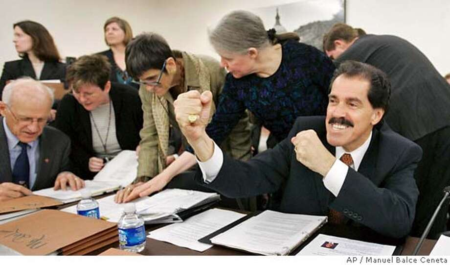 Rep. Jose Serrano, D-N.Y. right, makes a joking gesture to a colleague before the start of the House and Senate negotiators meeting on Capitol Hill, Monday, April 23, 2007, in Washington. A historic veto showdown assured, Democratic leaders agreed on legislation that requires the first U.S. combat troops to be withdrawn from Iraq by Oct. 1 with a goal of a complete pullout six months later. Republicans voiced opposition, but made no attempt to delay or even seek changes.(AP Photo/Manuel Balce Ceneta) Photo: Manuel Balce Ceneta