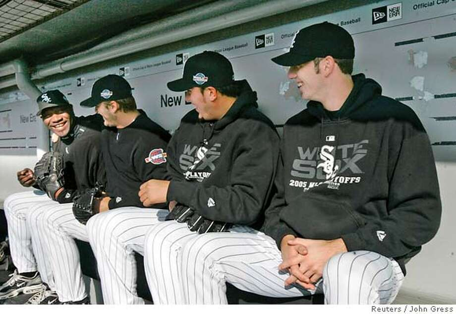 (L-R) American League champion Chicago White Sox pitchers Jose Contreras, Mark Buehrle, Freddy Garcia and Jon Garland share a laugh in the dugout during practice before the start of the World Series in Chicago October 21, 2005. Contreras will start Game 1 of the World Series in Chicago on October 22 when they take on the National League champion Houston Astros. REUTERS/John Gress 0 Photo: JOHN GRESS