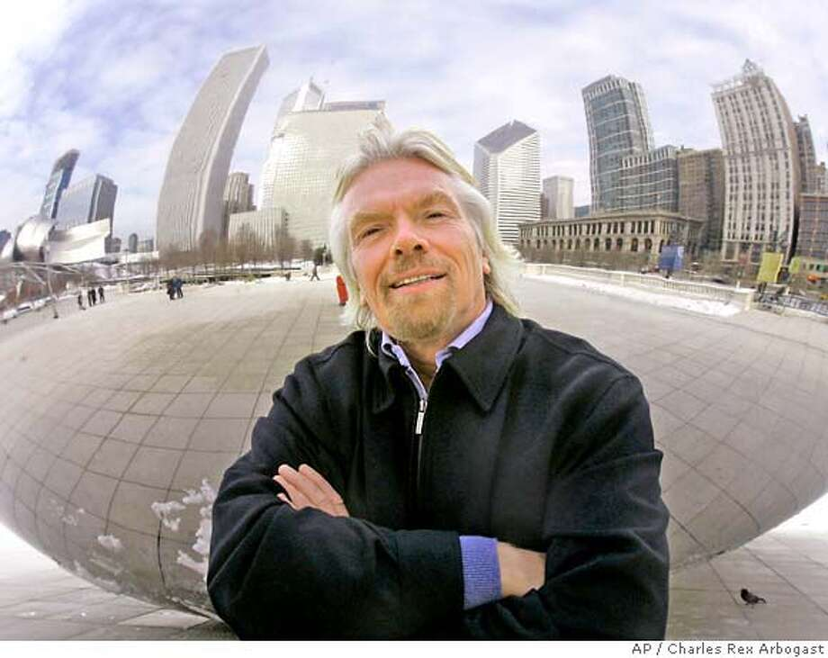 "**FILE** Sir Richard Branson is framed by a reflection of the Chicago skyline in Anish Kapoor's Cloud Gate sculpture as he poses, in this Dec. 4, 2006 file photo, in Chicago's Millennium Park. British Airways cut a cameo by Richard Branson from its in-flight version of the latest James Bond film and blurred out the tail fin of a Virgin Atlantic plane seen in the movie. BA's entertainment team cut a cameo appearance by Branson, chairman of the rival airline Virgin Atlantic, that appears in the original version of ""Casino Royale,"" a spokesman confirmed Saturday, April 22, 2007. In the original film, Branson can be seen turning around after walking through a metal detector at Miami Airport. (AP Photo/Charles Rex Arbogast, file) **DEC. 4, 2006 FILE PHOTO** Photo: CHARLES REX ARBOGAST"