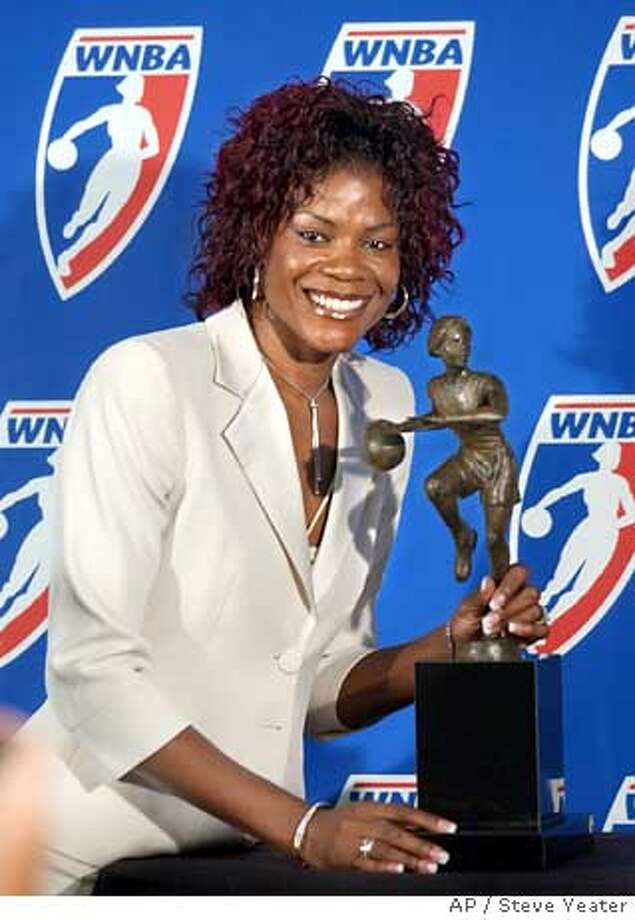 "*** FILE *** Sheryl Swoopes poses with the WNBA Most Valuable Player award after receiving the honor for the third time during a news conference in Sacramento, Calif., Sunday, Sept. 18, 2005. Swoopes is opening up about being a lesbian, telling a magazine that she's ""tired of having to hide my feelings about the person I care about."" Swoopes, honored last month as the WNBA's Most Valuable Player, told ESPN The Magazine for a story on newsstands Wednesday Oct. 26, 2005 that she didn't always know she was gay and fears that coming out could jeopardize her status as a role model. (AP Photo/Steve Yeater) Photo: STEVE YEATER"