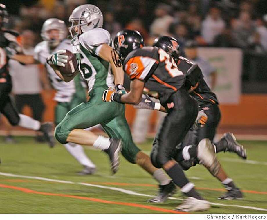 Tim Maupin makes it down to the one yard line in this second half run.  High School Football De La Salle Vs Pittsburg.  � PITTSBURG22_0322_kr.JPG 10/21/05 in PITTSBURG,CA.  KURT ROGERS/THE CHRONICLE MANDATORY CREDIT FOR PHOTOG AND SF CHRONICLE/ -MAGS OUT Photo: KURT ROGERS