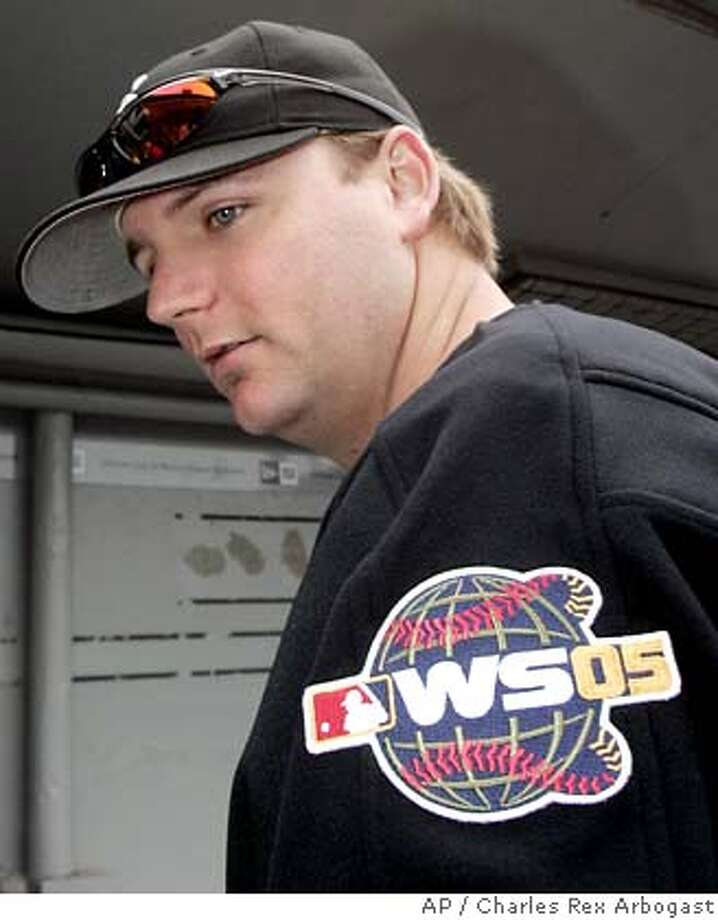 Chicago White Sox catcher A.J. Pierzynski sports the 2005 World Series patch on his left shoulder as he responds to a question after the White Sox's first workout for the 2005 World Series at US Cellular Field in Chicago Wednesday, Oct. 19, 2005. (AP Photo/Charles Rex Arbogast) Photo: CHARLES REX ARBOGAST