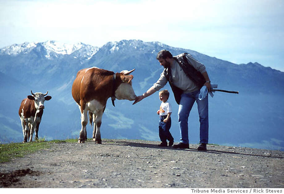TRAVEL STEVES SWITZERLAND -- In the Alps, you'll share the trail with cows.  Photo credit: Rick Steves / Tribune Media Services Photo: Rick Steves