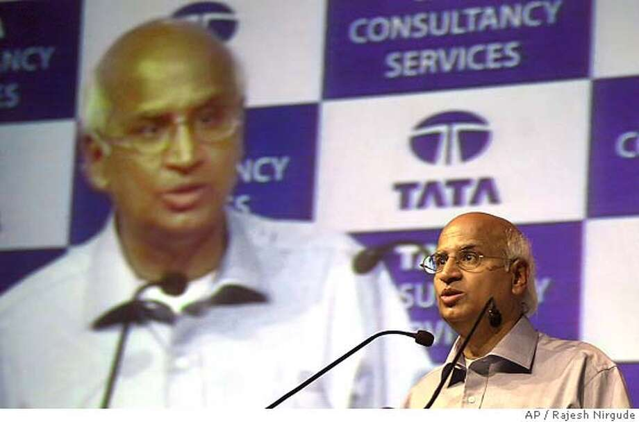 S. Ramadorai, Chief Executive Officer and Managing Director, Tata Consultancy Services (TCS) announces the financial results for the year 2004-05 in Bombay, India, Tuesday, April 19, 2005. India's top software company TCS on Tuesday said it fourth quarter profit dropped 34 percent, mostly due to a weakening dollar and performance incentives paid to employees. The company's net profit for the full financial year ending March 31 was 19.77 billion rupees (about US$449 million). Annual revenue stood at 97.48 billion rupees (about US$2.2 billion). (AP Photo/Rajesh Nirgude) Photo: RAJESH NIRGUDE