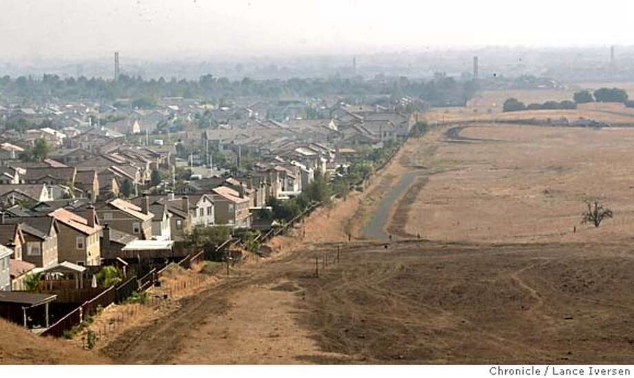 GROUTHXX_0019.jpg_  Antioch neighborhoods like this one in Southwest area of the city, off Deer Valley Rd are adjacent to open rangeland. Ballot measures on the November ballot in Brentwood, Antioch, Pittsburg and Livermore could open the doors for developers to Built homes, next to and on agricultural areas. By Lance Iversen/San Francisco Chronicle MANDATORY CREDIT PHOTOG AND SAN FRANCISCO CHRONICLE. Photo: Lance Iversen
