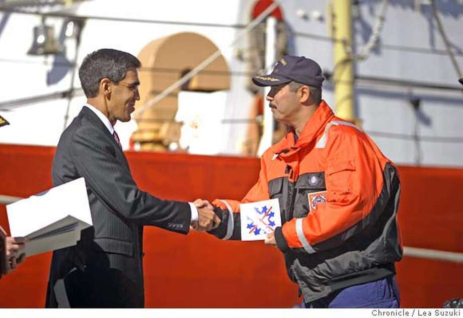 "From left: Uttam Dhillon, Director of Counter-Narcotics, Dept. of Homeland Security, shakes the hand of Capt. Charlie Diaz, commanding officer, Coast Guard cutter Sherman as he issues the ""snowflake"" drug bust emblems for placement on the ship.  Approximately 20 tons of cocaine seized by the Coast Guard Cutter Sherman in mid-March is offloaded at Berth 2 at the Coast Guard Island in Alameda.  Photo taken on 4/23/07, in Alameda, CA. Photo by Lea Suzuki/ The Chronicle ()cq Photo: Lea Suzuki"