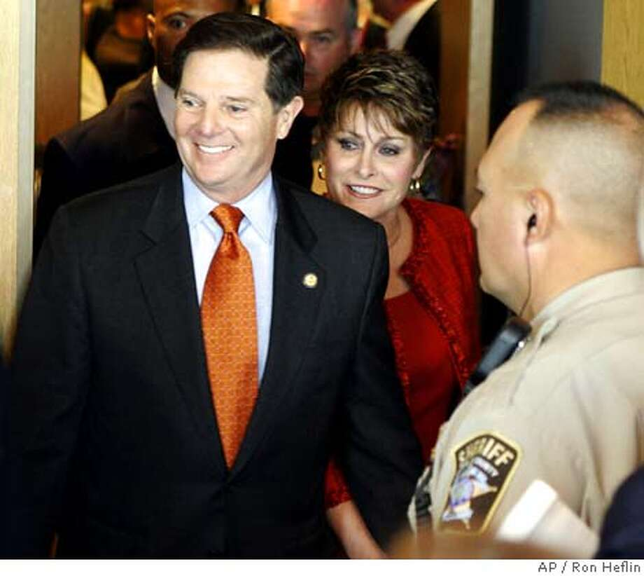 Rep. Tom DeLay leaves an Austin, Texas, courtroom, with his wife Christine, Friday, Oct. 21, 2005, after making his first court appearance on money laundering and conspiracy charges. (AP Photo/Ron Heflin) Photo: RON HEFLIN
