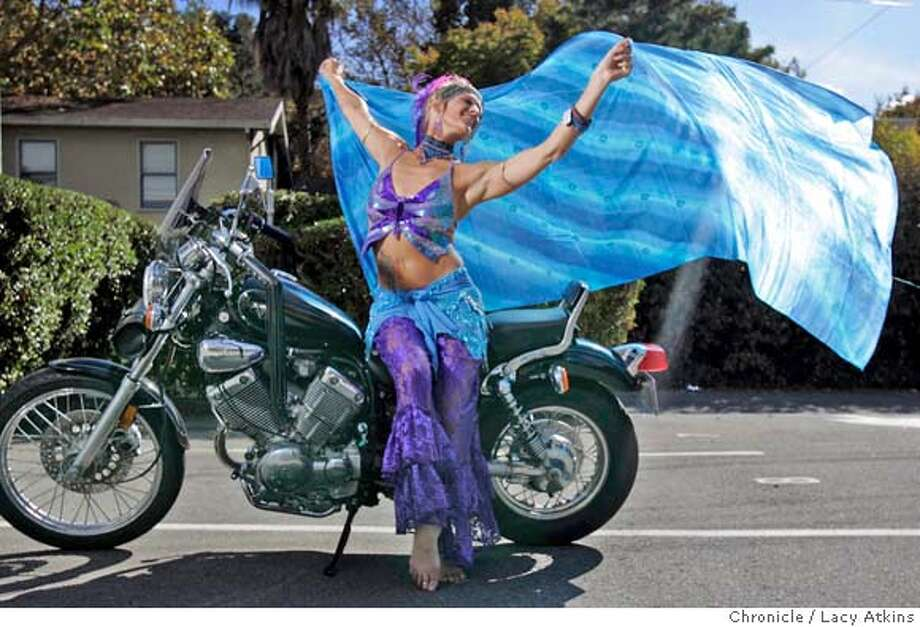 Aruna, a belly dancer in San Anselmo and her Yamaha, Oct. 19, 2005.  Story is about the huge rise in the number of women motorcyclists. Not just biker chicks, but more and more women of all ages are buying and riding motorcycles. Koopman is profiling two riders. This assignment is for a woman who uses one name, Aruna. She has a belly-dance studio in San Anselmo. Please contact her there, at 457-8787, to arrange photos. She has a Yamaha motorcycle and full leathers.lingame.  PHOTO BY Lacy atkins Photo: Lacy Atkins