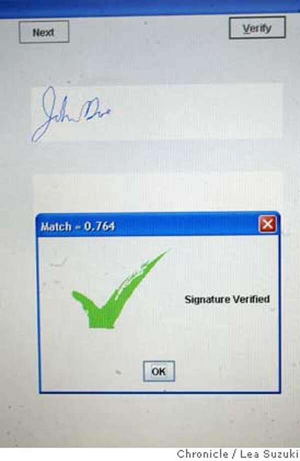 ibmxx_048ls.JPG  A window pops open whose message indicates whether the signature has been verified. Thomas Zimmerman, IBM researcher, at IBM Almaden Research Center, talks about the new signature verification technology. IBM is developing new signature verification technology that could be used to guard against credit card fraud. Demo at IBM Almaden Research Center in San Jose. NOTE: Pls contact IBM PR for press info. Photo taken on 10/19/05 in San Jose, CA. Photo by Lea Suzuki/ The San Francisco Chronicle /MAGAZINES OUT Photo: Lea Suzuki