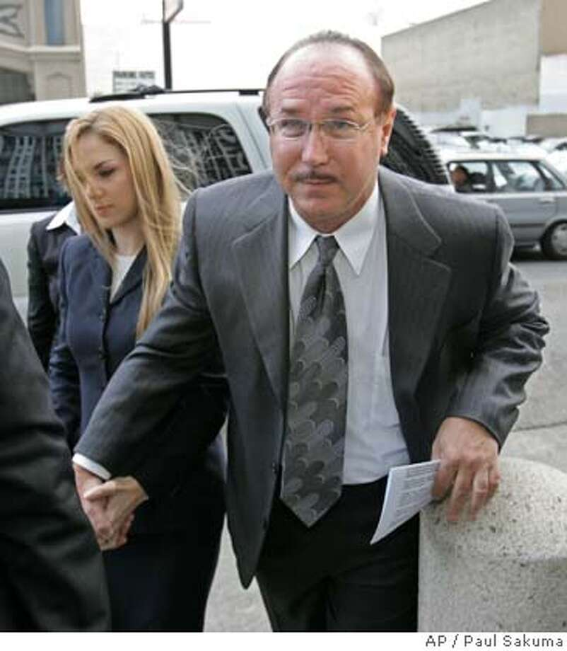 BALCO founder Victor Conte arrives with his daughter, Veronica Ekhardt, at a federal courthouse in San Francisco, Tuesday, Oct. 18, 2005 where he was sentenced to eight months as part of a plea deal for his role as mastermind behind a scheme to provide professional athletes with undetectable performance-enhancing drugs. (AP Photo/Paul Sakuma) Photo: PAUL SAKUMA