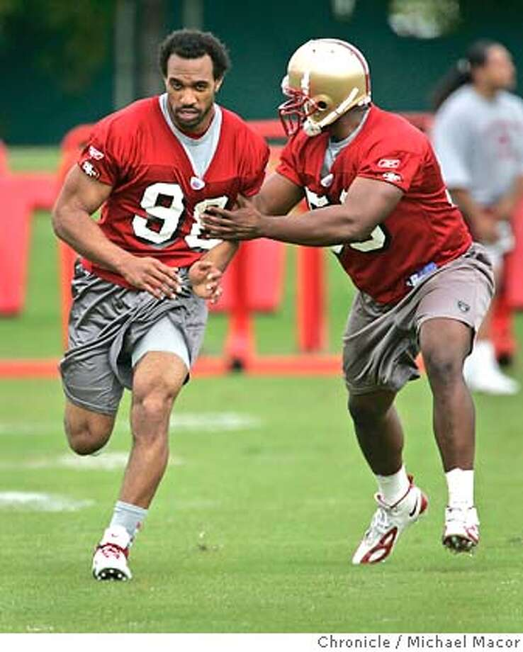 49ers_339_mac.jpg Niners 98- Julian Peterson and 59- Ray Wells work on drills during practice. San Francisco 49ers hold their first mandatory mini-camp of the season. Chance to see new players, coach Mike Nolan at work. 5/6/05 Santa Clara, Ca Michael Macor / San Francisco Chronicle Ran on: 09-06-2005 Mandatory Credit for Photographer and San Francisco Chronicle/ - Magazine Out Photo: Michael Macor