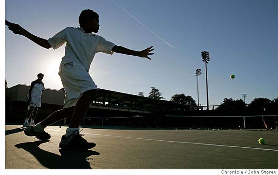 Deven Williams hitting as the sun sets. The East Palo Alto Tennis and tutoring program being run at Stanford. John Storey Palo Alto Event on 10/5/05 Photo: John Storey