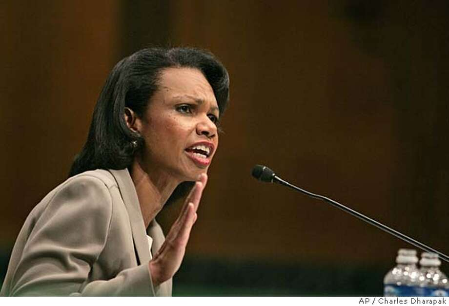 U.S. Secretary of State Condoleezza Rice responds to questioning by Sen. Barbara Boxer, D-Calif., during her testimony before the Senate Foreign Relations committee Wednesday, Oct. 19, 2005 on Capitol Hill in Washington. Rice on Wednesday refused to rule out U.S. troops still serving in Iraq in 10 years or the possibility that the United States could use military force against neighboring Syria and Iran. (AP Photo/Charles Dharapak) Ran on: 10-20-2005  Condoleezza Rice testifies before the Senate committee. Photo: CHARLES DHARAPAK