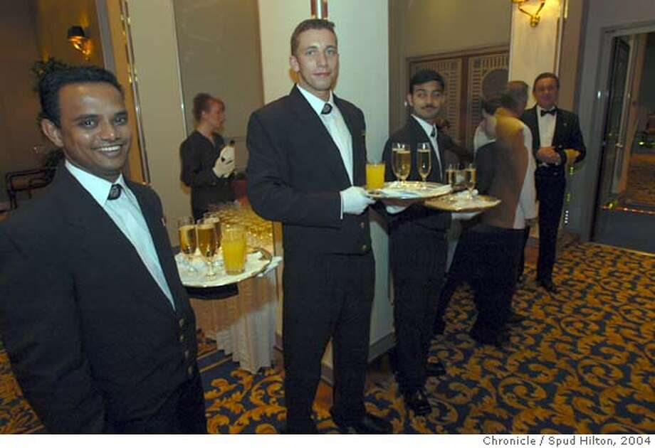 travel_qm2_003_sh.jpg The Cunard ship Queen Mary 2, during a roundtrip 3/19/04 from Fort Lauderdale. Waiters dole out drinks during the Captain's cocktail party. Spud Hilton / The Chronicle  Ran on: 04-22-2007  Enjoying cocktails on board, like those on the Queen Mary 2, is fine by cruise lines -- but not necessarily if you mix them yourself. Photo: Spud Hilton