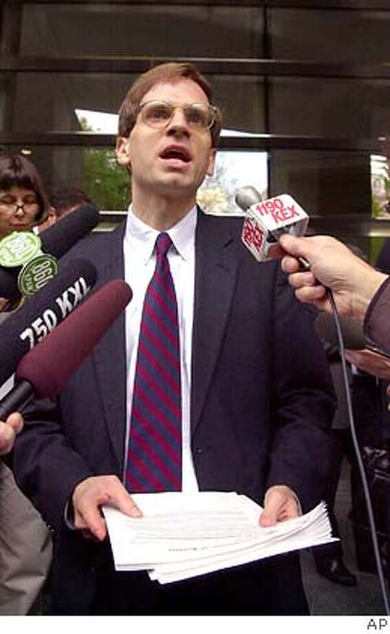 Assistant U.S. Attorney General Gregory Katsas reads a statement on the steps of the federal courthouse in Portland, Ore., Wednesday, May 7, 2003, after oral arguments were heard in the 9th U.S. Circuit Court of Appeals regarding Oregon's landmark assisted suicide law. U.S. Attorney General John Ashcroft appealed a ruling against him last year after the state of Oregon sued him for trying to prevent doctors from writing prescriptions under the assisted suicide law. (AP Photo) muglet; CAT Photo: Ap