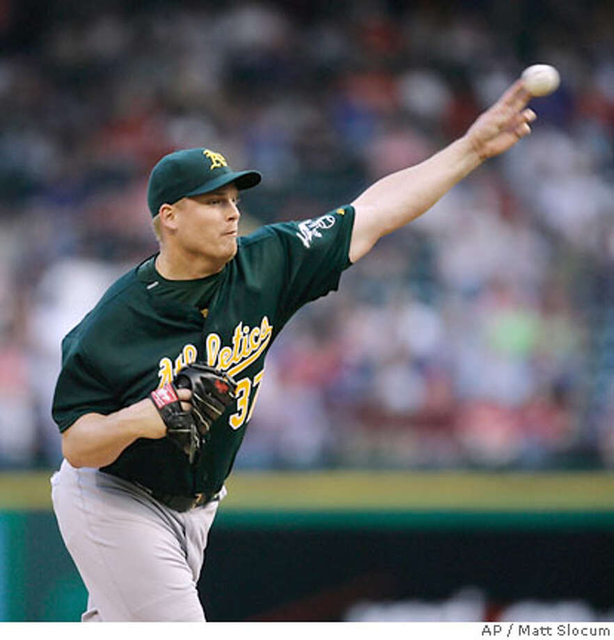 Oakland Athletics pitcher Joe Kennedy throws in the first inning of an MLB baseball game against the Texas Rangers, Saturday, April 21, 2007, in Arlington, Texas. (AP Photo/Matt Slocum) Photo: Matt Slocum