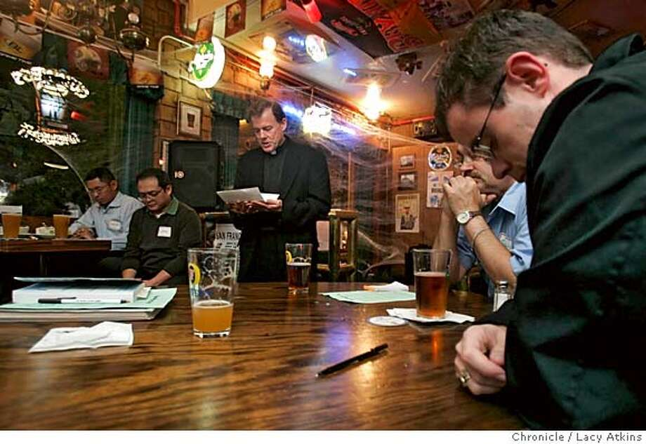 "Bishop John C. Wester leads the group "" on Tap"" in prayer at the Ireland 32 Bar, Tuesday Oct. 18, 2005 in San Francisco. (Man in black on right is Brad Battles) Catholic Church brings talk of religion and church policy to popular pub Ireland 32 as way to nab the beer-drinking young crowd in 20s and 30s. Let's get shots of guest speakers on and off stage, attendees listening and drinking  PHOTO BY Lacy atkins Photo: Lacy Atkins"