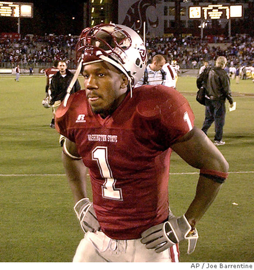Washington State's Jerome Harrison leaves the field after losing to UCLA at Martin Stadium in Pullman, Wash. Saturday, Oct. 15, 2005. UCLA won 44-41 in overtime.(AP Photo/Joe Barrentine) Photo: JOE BARRENTINE