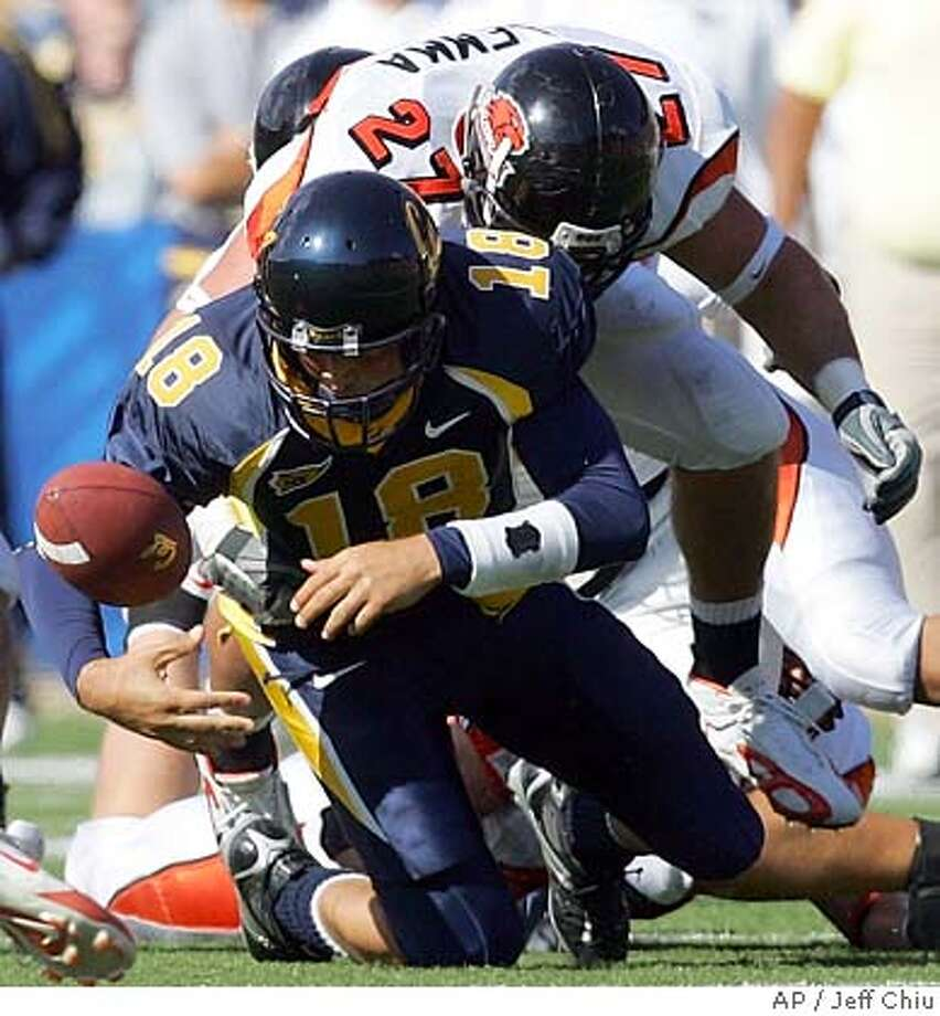 California quarterback Joe Ayoob (18) fumbles in front of Oregon State's Joe Lemma in the third quarter in Berkeley, Calif., on Saturday, Oct. 15, 2005. Oregon State won, 23-20. (AP Photo/Jeff Chiu) Photo: JEFF CHIU