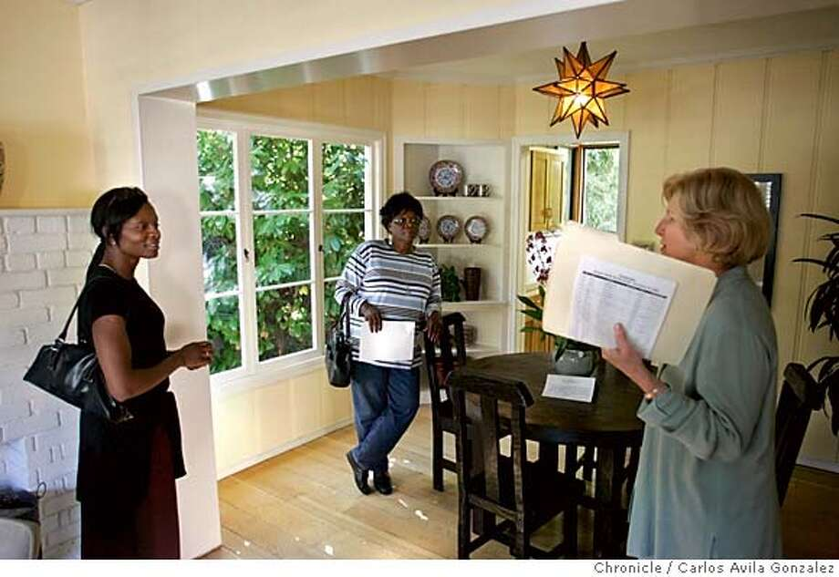 HOMES18_002_CG.JPG  Azuka Nwigwe, left, and her mother, Evelyn Nwigwe, center speak with Linda McCrain, right, about the home at 870 Sunnyhills Road in Oakland, Ca., on Sunday, October 16, 2005. McCrain works for Angela Wei, who is the realtor on the property. DataQuick will release its monthly Bay Area home sales report sometime the week of October 17. Some shots of would-be buyers touring open homes on Sunday, October 16, 2005.  Photo by Carlos Avila Gonzalez / The San Francisco Chronicle  Photo taken on 10/16/05, in Oakland,CA. Photo: Carlos Avila Gonzalez