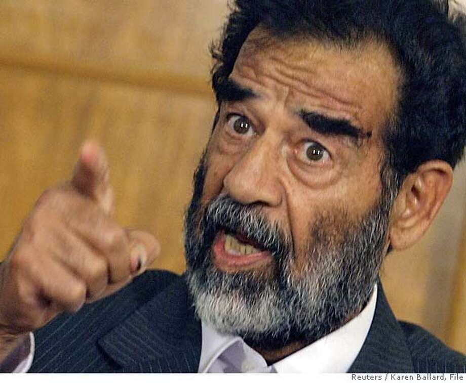 Saddam Hussein appears before a tribunal in Baghdad in this July 1, 2004 file photo. Hussein and seven members of his Baath party, including his half-brother, will file into a marble-lined, chandelier-hung courtroom in Baghdad on October 19, 2005 to face the stares of five judges and the world. Two years after he was found hiding in a hole near where he was born, the former Iraqi president and his co-defendants are on trial for their lives on charges of crimes against humanity for the killing of over 140 Shi'ite Muslim men two decades ago. REUTERS/Karen Ballard/File 0 Photo: POOL