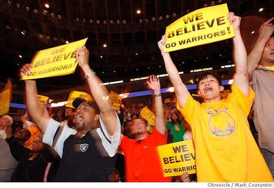 (l-r) Ralph Matthews and Stacey Leong cheer during 2nd half at the Oracle Arena in Oakland, CA, April 18, 2007. FANS REACT TO THE V. PORTLAND GAME. PHOTO: Mark Costantini / The Chronicle Photo: MARK COSTANTINI