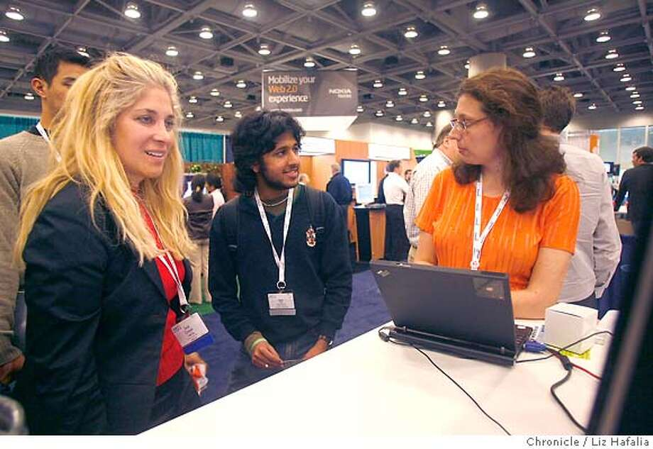 WEB18_119_LH_.JPG The Web 2.0 Expo at Moscone West in San Francisco. Hagit Katzenelsen from esnips explains the company to Seval Ozveren (left), from LeapTag, and Nitesh Goel (middle), from Stanford. Liz Hafalia/The Chronicle/San Francisco/4/18/07  **Hagit Katzenelsen, Seval Ozveren, Nitesh Goel cq �2007, San Francisco Chronicle/ Liz Hafalia  MANDATORY CREDIT FOR PHOTOG AND SAN FRANCISCO CHRONICLE. NO SALES- MAGS OUT. Photo: Liz Hafalia