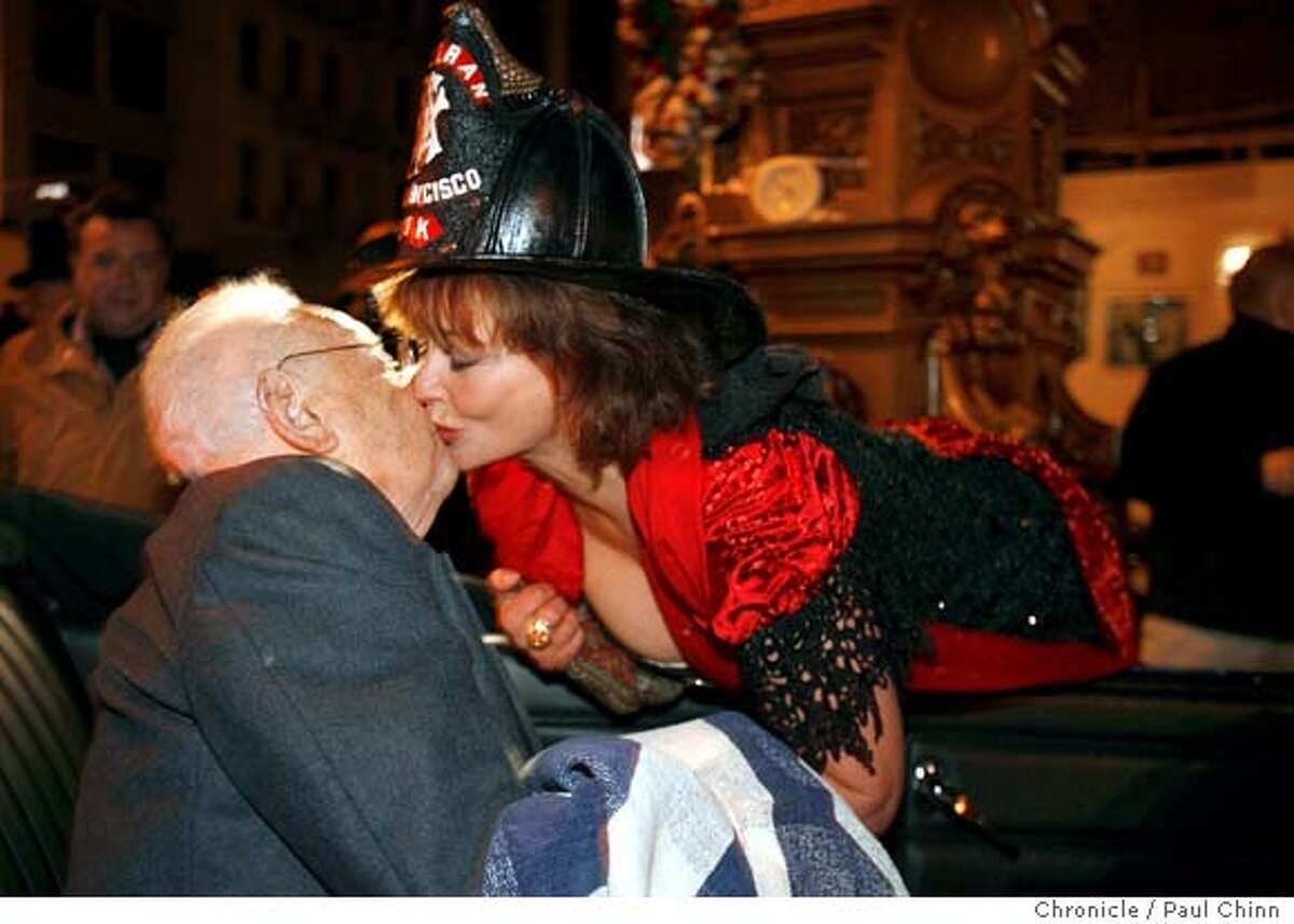 Donna Huggins kisses earthquake survivor Herbert Hamrol before the start of 101st anniversary celebration of the 1906 earthquake at Lotta's Fountain in San Francisco, Calif. on Wednesday, April 18, 2007. About 200 people attended this year's commemoration. PAUL CHINN/The Chronicle **Donna Huggins, Herbert Hamrol