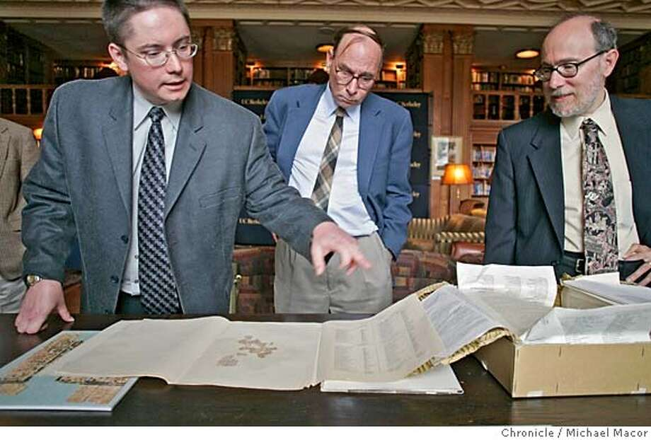 "papyri_049_mac.jpg Todd Hickey, Curator of the Papyrus Collection at UC Berkeley, Anthony Bliss, Rare Books Librarian and Donald Mastronarde, Director of the Center for the Tebtunis Papyrus Collection, sort through the pages and pages of the collection of 2000 year old documents. Hickey points out an a piece of the manuscript from Homer's Odessey. The return to the University of California, Berkeley, of three tins of ancient papyri collected from Oxford University. The papyri were originally gathered from the ruins of the Egyptian community of Tebtunis west of the Nile during a UC Berkeley archaeological expedition in 1899 and 1900 at the behest of late university benefactor Phoebe Apperson Hearst.  Some of the materials on display at this event will include fragments of Euripides' ""Phoenician Women"" and Homer's ""Odyssey,"" a priestly encyclopedia in hieroglyphics, and papers of an influential prophetess of the local Tebtunis crocodile god. 10/18/05 in Berkeley, {state.} Michael Macor / San Francisco Chronicle Mandatory Credit for Photographer and San Francisco Chronicle/ - Magazine Out Photo: Michael Macor"