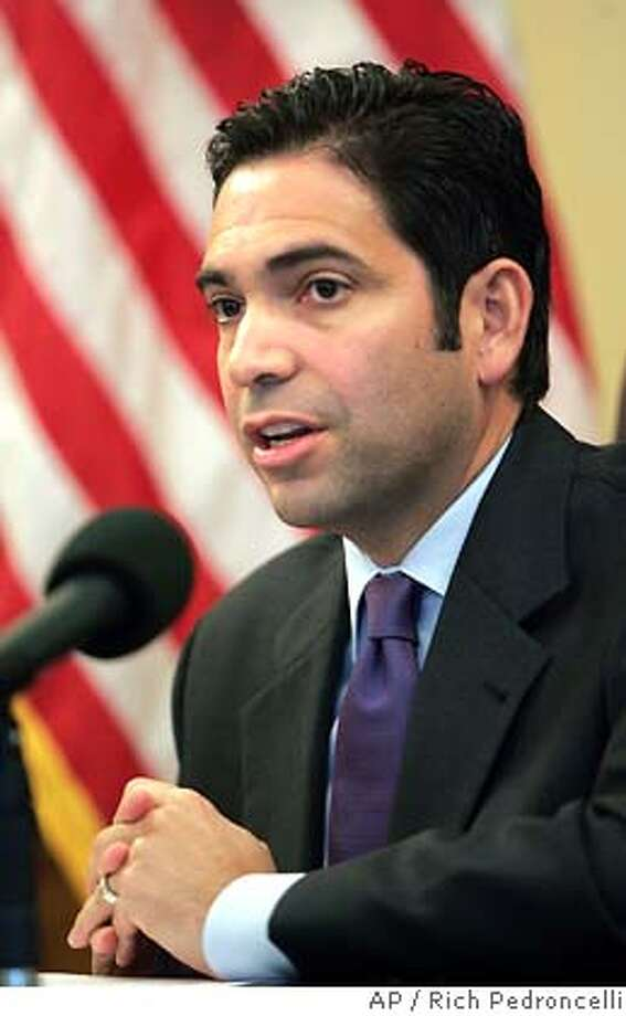 Assembly Majority Leader Dario Frommer, D-Los Angeles, criticized Gov. Arnold Schwarzenegger for failing to meet with President George Bush during the president's recent visit to California during news conference in Sacramento, Calif., Thursday, Oct. 20, 2005. Democrats contend Schwarzenegger did not want to meet with Bush because of political reasons concerning the upcoming special election. Frommer claimed the governor missed an opportunity to meet with the president to request more financial aid for California. (AP Photo/Rich Pedroncelli) Photo: RICH PEDRONCELLI