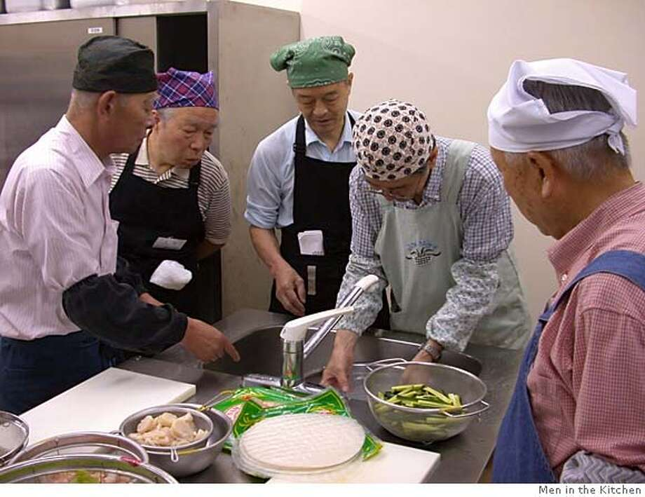 "Retired banker Tomohisa Kotake, second from left, participates in a cooking class at a Men in the Kitchen support group meeting in western Tokyo. Support groups aim to ""re-train'' retired Japanese men to be more independent and communicative with their wives. Illustrates JAPAN (category i), by Anthony Faiola (c) 2005, The Washington Post. Moved Monday, Oct. 17, 2005. (MUST CREDIT: Courtesy of Men in the Kitchen.) Photo: MEN IN THE KITCHEN"