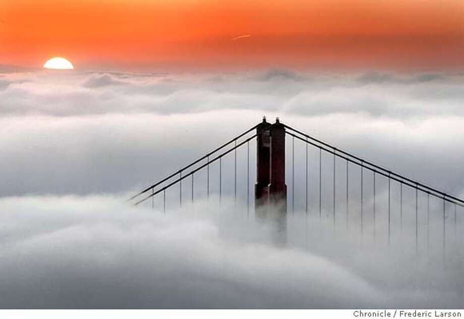 FOG01_fl.jpg A rising sun peeked over a blanket of fog that overwhelmed the bay as spring mild temperatures continue throughout the week. San Francisco CA Frederic Larson  The San Francisco Chronicle Photo: Frederic Larson