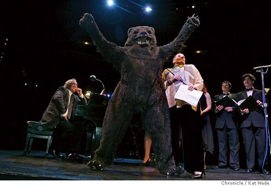 LIVELY19_074_KW.jpg  On 10/17/05 in San Francisco (L to R) with Music Director Donald Runnicles at the piano, dramaturg Wolfgang Willaschek dressed as a bear and joined the director of the Opera Center Sheri Greenawald and the Adlers Fellows ont stage when the San Francisco Opera hosted a private dinner and party for outgoing general director Pamela Rosenberg on the stage at the War Memorial Opera House Monday night.  Kat Wade/The Chronicle MANDATORY CREDIT FOR PHOTOG AND SF CHRONICLE/ -MAGS OUT Photo: Kat Wade