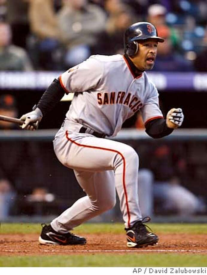 San Francisco Giants' Dave Roberts follows the flight of his RBI triple off Colorado Rockies starting pitcher Jason Hirsch in the third inning of a baseball game in Denver on Tuesday, April 17, 2007. (AP Photo/David Zalubowski) Photo: David Zalubowski