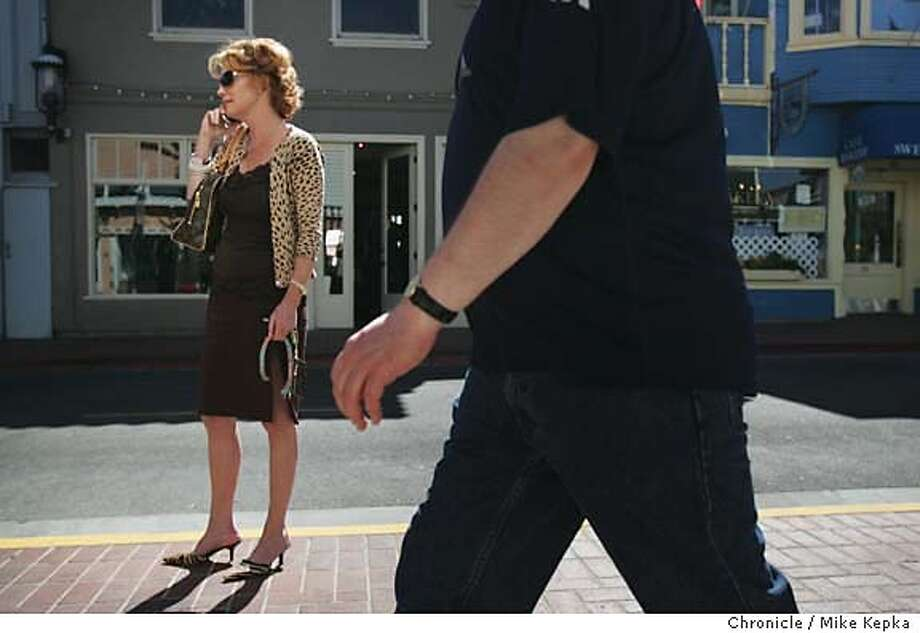 12:58 p.m. Wearing her fall colors, Maureen Herr makes a social call before heading to pet store for a new dog collar. headOn Location Main Street in Tiburon. date} Mike Kepka / The Chronicle Photo: Mike Kepka