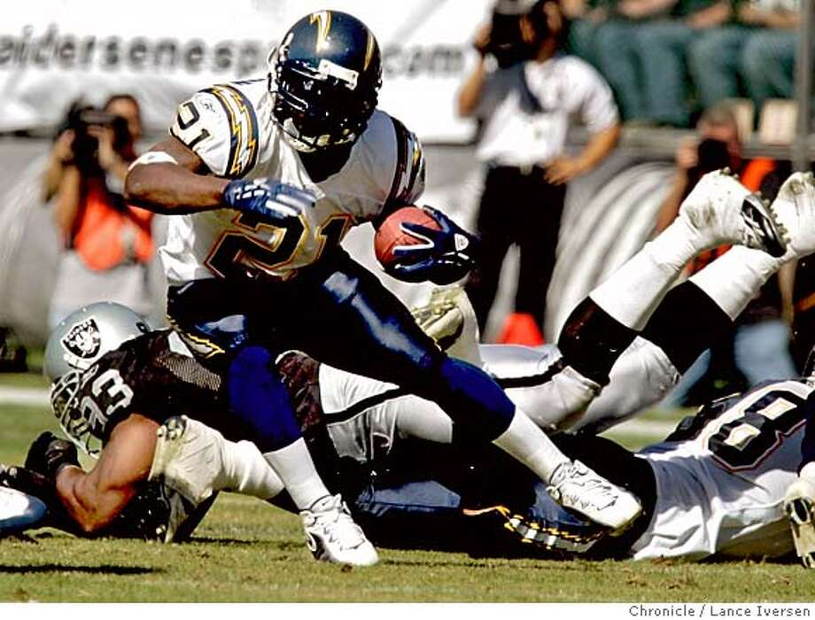RAIDERS_0155.jpg_  San Diego Chargers #21 LaDainian Tomilinson scrambles for a first down in their 27-14 win over Oakland Raiders at McAfee Coliseum. By Lance Iversen/San Francisco Chronicle Photo: Lance Iversen