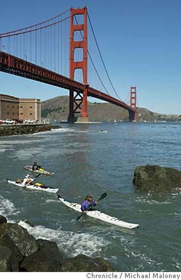 NCOAST_SF_097_MJM.jpg  Bo Barnes, Paul McHugh and John Weed paddle the shoreline near Fort Point on route to the finnish at Crissy Field.  After a 6 week journey, the kayakers enter SF bay and land at Crissy Field where friends and relatives were waiting to welcome them.  Rediscovering California's North Coast. A kayak voyage by Paul McHugh, Bo Barnes and John Weed. A paddle from the Oregon border to the SF bay.  Photo taken on 10/16/05 in San Francisco, CA by Michael Maloney / San Francisco Chronicle MANDATORY CREDIT FOR PHOTOG AND SF CHRONICLE/ -MAGS OUT Photo: Michael Maloney